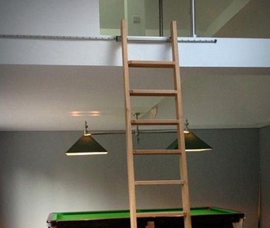 Rolling ladders for mezzanine access