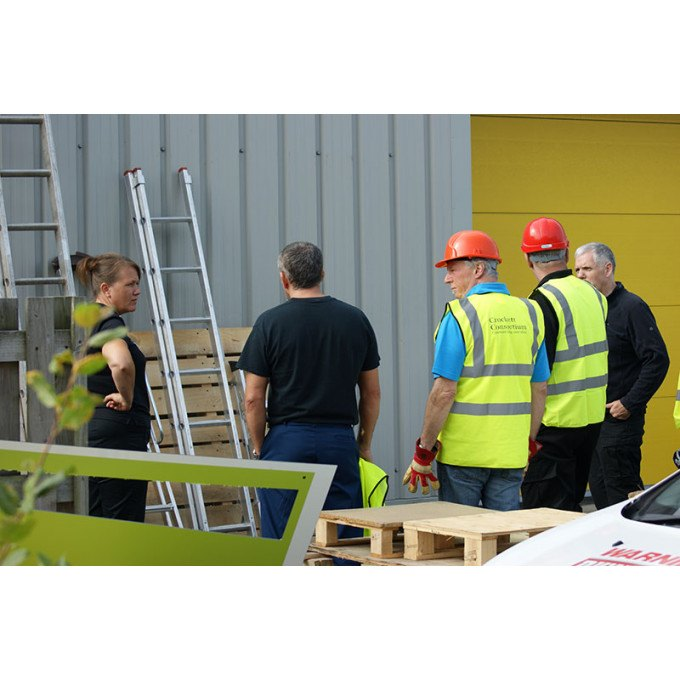 Group inspecting ladders on the Ladder Users & Inspectors Course